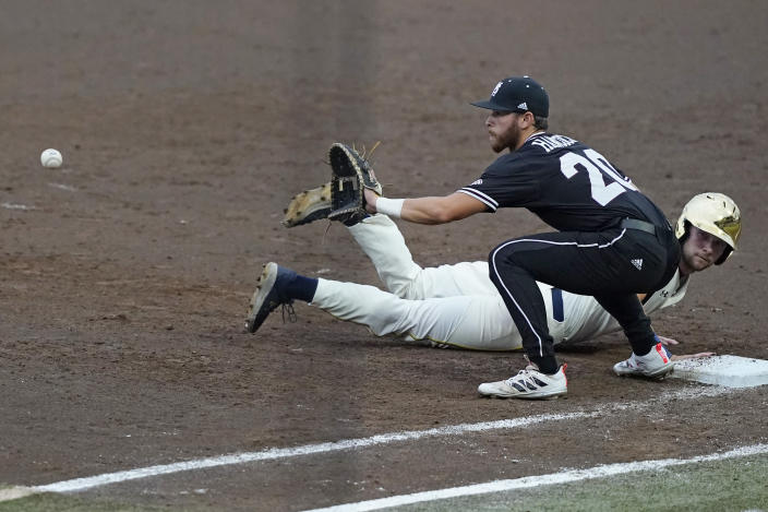 Notre Dame's Carter Putz (4) beats a throw back to first base as Mississippi State's Luke Hancock (20) waits for the ball during an NCAA college baseball super regional game, Sunday, June 13, 2021, in Starkville, Miss. (AP Photo/Rogelio V. Solis)