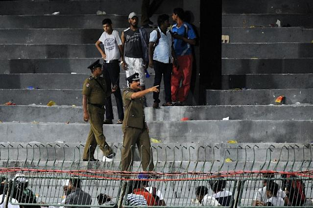 Sri Lankan police clear the terraces after groups of supporters of both sides clashed during the third one-day international (ODI) between Sri Lanka and Pakistan at the R Premadasa International Cricket Stadium in Colombo on July 19, 2015 (AFP Photo/Ishara S. Kodikara)