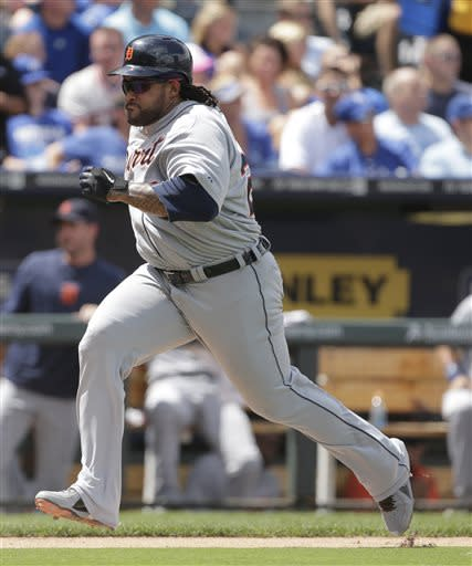 Detroit Tigers' Prince Fielder runs home to score on a sacrifice fly by Brayan Pena during the seventh inning of a baseball game against the Kansas City Royals, Sunday, July 21, 2013, in Kansas City, Mo. (AP Photo/Charlie Riedel)