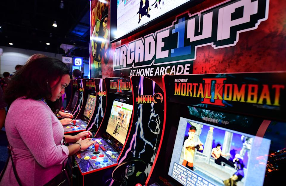 A woman plays 'Mortal Kombat 2' on an 1980's console by Arcade 1Up at the 2019 Electronic Entertainment Expo, also known as E3, opening in Los Angeles, California on June 11, 2019. - Gaming fans and developers gather, connecting thousands of the brightest, best and most innovative in the interactive entertainment industry and a chance for many to preview new games. (Photo by Frederic J. BROWN / AFP)        (Photo credit should read FREDERIC J. BROWN/AFP via Getty Images)
