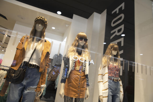 Fashions are displayed in the window of a Forever 21 clothing store, Monday, Sept. 30, 2019, in New York. Low-price fashion chain Forever 21, a one-time hot destination for teen shoppers that fell victim to its own rapid expansion and changing consumer tastes, has filed for Chapter 11 bankruptcy protection. (AP Photo/Mark Lennihan)