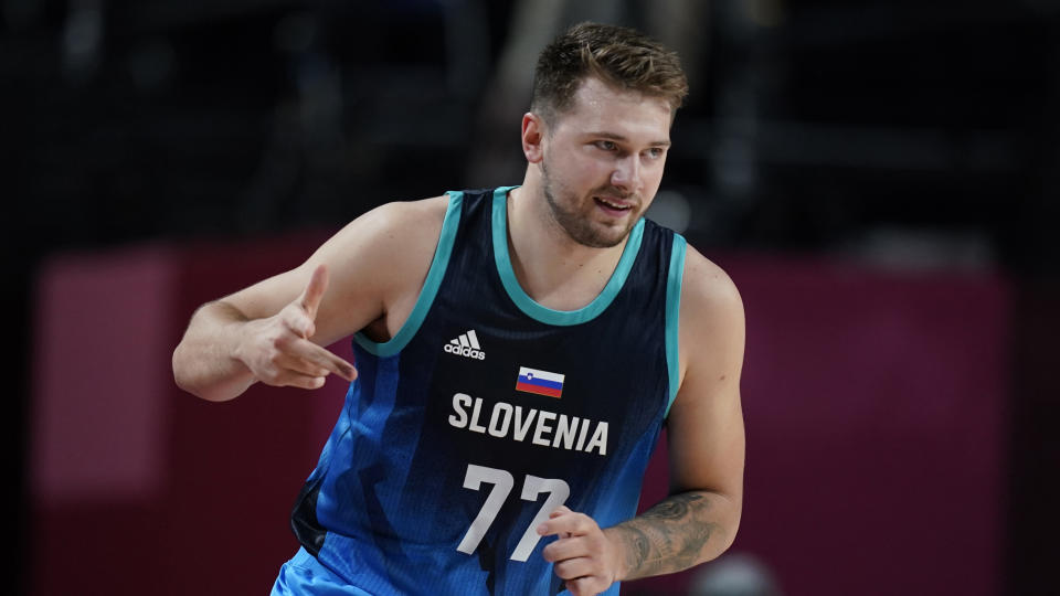 Slovenia's Luka Doncic (77) celebrates after three point basket during men's basketball preliminary round game against Argentina at the 2020 Summer Olympics, Monday, July 26, 2021, in Saitama, Japan. (AP Photo/Charlie Neibergall)