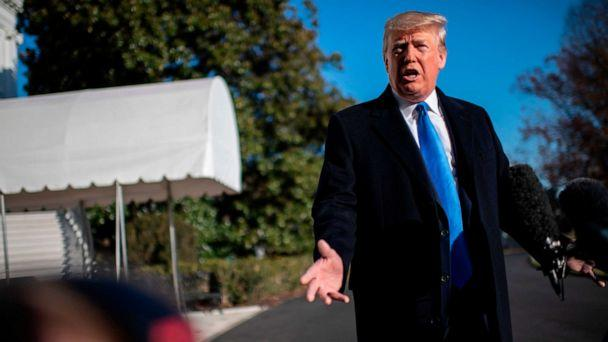 PHOTO: President Donald Trump answers questions from the media before departing the White House on Dec. 7, 2019, in Washington, D.C. (Eric Baradat/AFP via Getty Images)