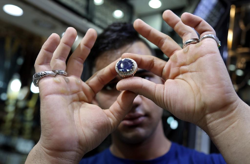 For many pilgrims visiting the Iraqi Shiite holy city of Najaf, buying a gemstone ring is part and parcel of the experience (AFP Photo/)