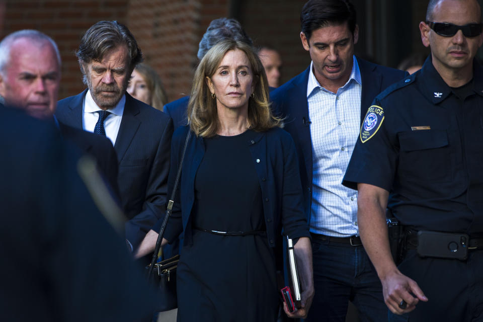 Felicity Huffman, with William H. Macy, leaves court after being sentenced. (Photo: Nic Antaya for the Boston Globe via Getty Images)