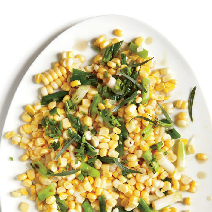 """<p>This combo goes well with grilled chicken or flank steak. Or serve with grilled zucchini planks.</p> <p> <a rel=""""nofollow noopener"""" href=""""http://www.myrecipes.com/recipe/grilled-green-onions-corn-tarragon"""" target=""""_blank"""" data-ylk=""""slk:View Recipe: Grilled Green Onions with Corn and Tarragon"""" class=""""link rapid-noclick-resp"""">View Recipe: Grilled Green Onions with Corn and Tarragon</a></p>"""