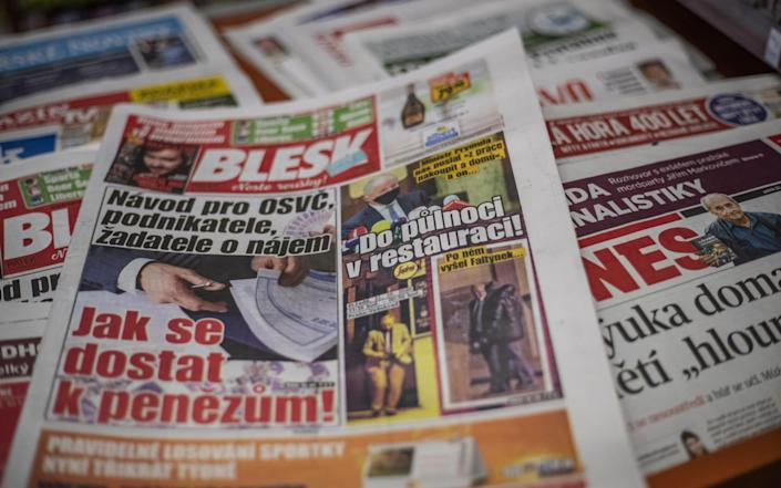 A copy of Czech daily Blesk showing pictures of Czech Health Minister Roman Prymula leaving a restaurant in Prague - Shutterstock
