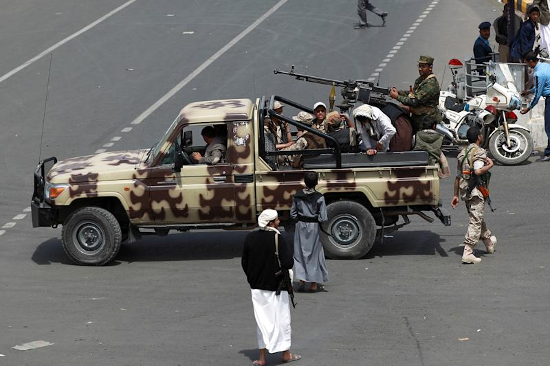 Supporters of the Yemeni Shiite Huthi movement guard a funeral procession, for members of the movement killed in a suicide bombing last week, in the capital Sanaa on October 14, 2014 (AFP Photo/Mohammed Huwais)