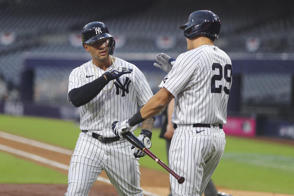 Gleyber Torres of the New York Yankees celebrates with Gio Urshela after hitting a two-run home run in the sixth inning during Game 4 of the ALDS. (Photo by Alex Trautwig/MLB Photos via Getty Images)