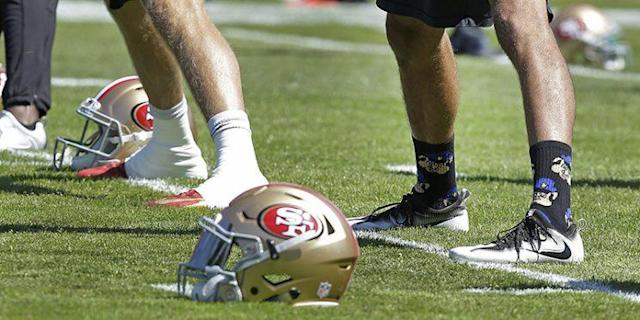 "<a class=""link rapid-noclick-resp"" href=""/nfl/players/24823/"" data-ylk=""slk:Colin Kaepernick"">Colin Kaepernick</a> wore these socks during practice on Aug. 10. (AP)"