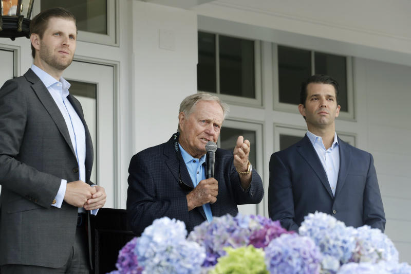 In this June 11, 2018 photo, Eric Trump, left, Jack Nicklaus, center, and Donald Trump Jr. attend the opening of the Trump Golf Links clubhouse in the Bronx borough of New York. President Donald Trump's company posted annual losses at his golf course in the Bronx for the first time since it opened four years ago as expenses rose, greens fees barely budged and the opening of a clubhouse was delayed.  (AP Photo/Mark Lennihan)