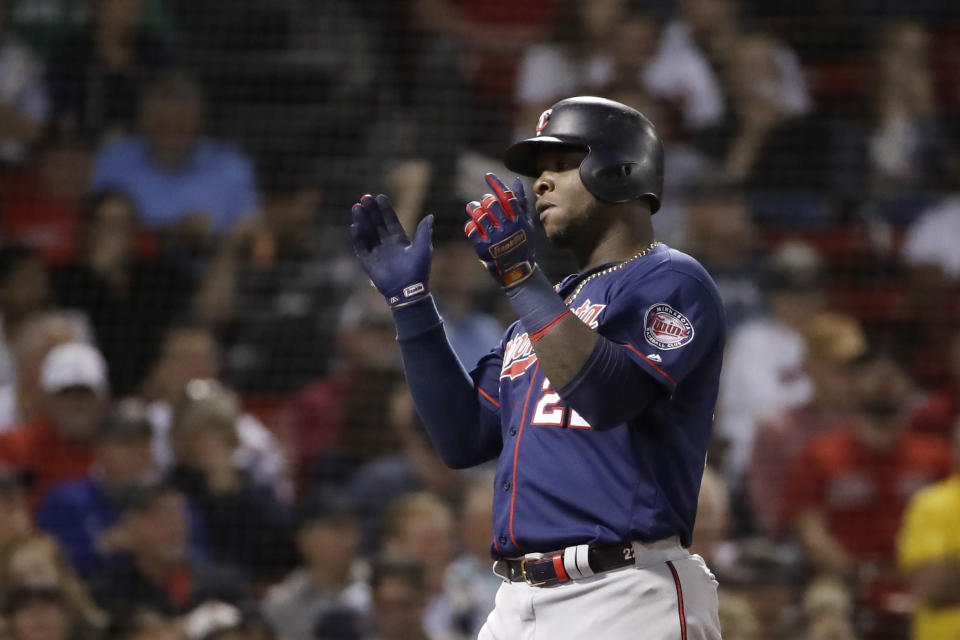 Minnesota Twins' Miguel Sano celebrates his two-run home run against the Boston Red Sox during the fifth inning of a baseball game at Fenway Park, Tuesday, Sept. 3, 2019, in Boston. (AP Photo/Elise Amendola)