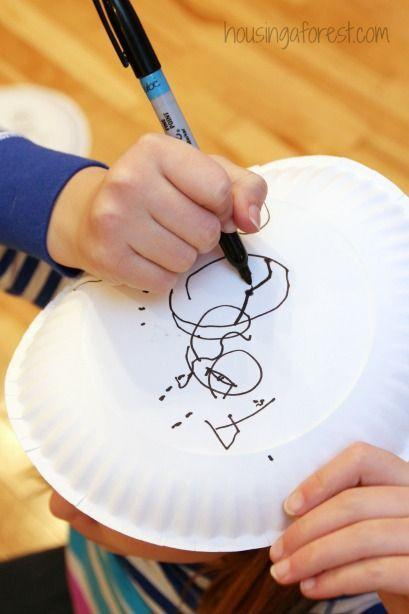 """<p>Budding artists, this is your moment: The top-of-your-head snowman drawing contest makes a fun and silly holiday activity. It might just reveal some hidden talent! Drawing on top of your head is a lot harder than you may think, so we recommend washable markers.</p><p><em><a href=""""http://www.housingaforest.com/christmas-party-games-for-kids/"""" rel=""""nofollow noopener"""" target=""""_blank"""" data-ylk=""""slk:Get the tutorial at Housing a Forest »"""" class=""""link rapid-noclick-resp"""">Get the tutorial at Housing a Forest »</a></em><br></p>"""