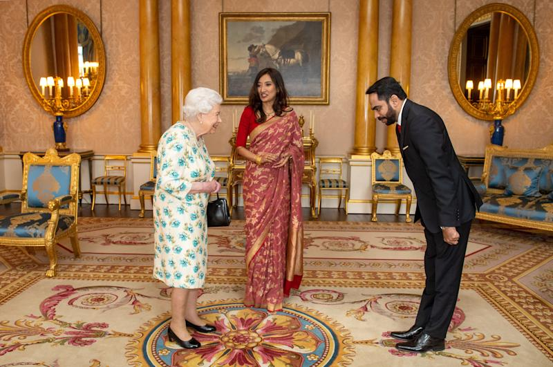 Queen Elizabeth II meets meets High Commissioner of Sri Lanka Saroja Sirisena and Sudath Talpahewa (right) during an audience at Buckingham Palace, London.