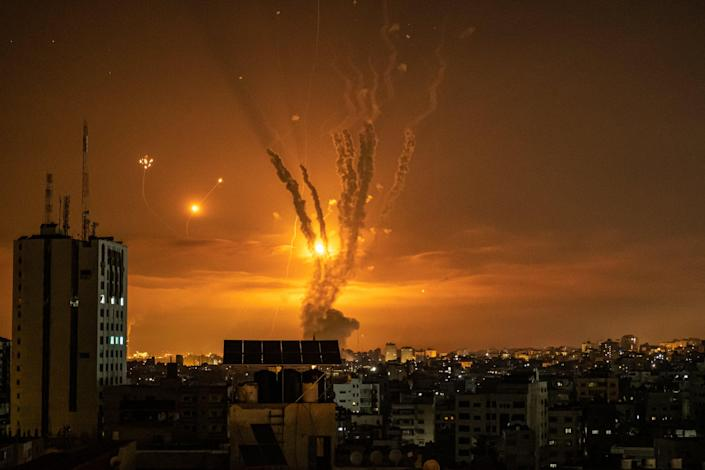 Rockets launched towards Israel from the northern Gaza Strip and a response from the Israeli missile defense system known as the Iron Dome leave streaks through the sky over Gaza CityFatima Shbair/Getty