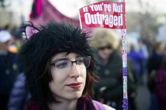 <p>A demonstrator marches during the Denver's Women's March in Denver, Colo., on Jan. 20, 2018, one year after thousands of supporters marched around the world in defense of women's and human rights. (Photo: Jason Connolly/AFP/Getty Images) </p>