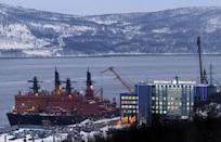 Atomic icebreakers Russia and Yamal are seen moored at Atomflot (Rosatomflot), the operator of Russia's nuclear icebreaker fleet, base in the Arctic port of Murmansk, Russia December 22, 2011. Picture taken December 22, 2011. REUTERS/Andrei Pronin