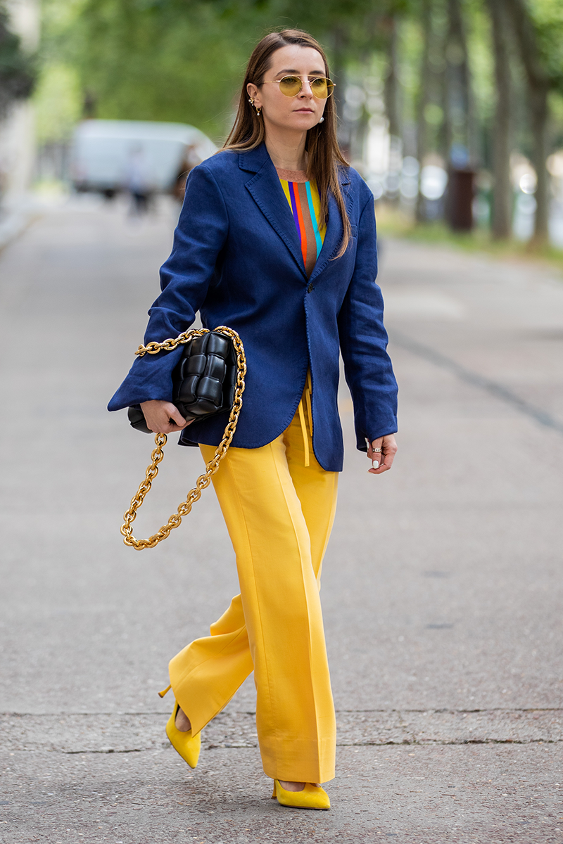 <p>Here's a more colourful take on the trouser suit, with contrasting trousers, pumps and a technicolour top poking through.</p>
