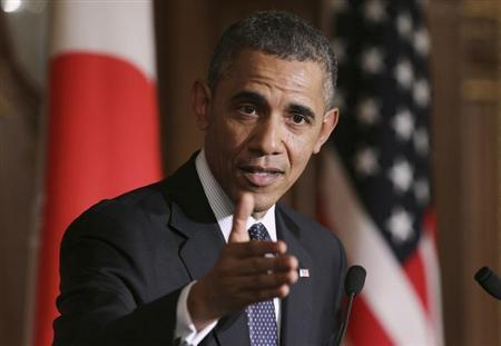 U.S. President Obama gestures during a news conference with Japanese Prime Minister Abe at the Akasaka guesthouse in Tokyo