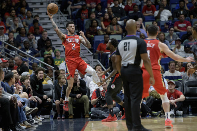 New Orleans Pelicans guard Lonzo Ball (2) jumps to keep a ball inbounds against the Los Angeles Clippers in the first half an NBA basketball game in New Orleans, Saturday, Jan. 18, 2020. (AP Photo/Matthew Hinton)