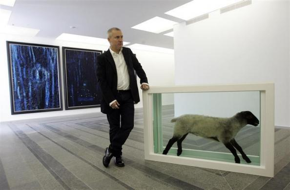 British artist Damien Hirst stands next to one of his sculptures during a press preview of his exhibition at the Pinchuk Art Center in Kiev April 23, 2009.