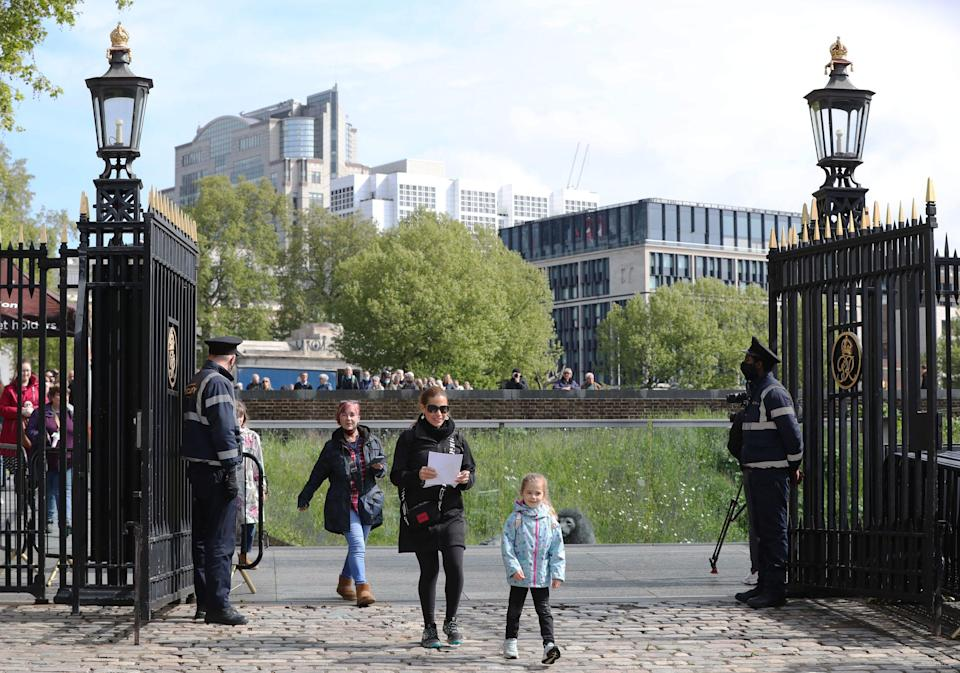 <p>Visitors arrive at the Tower of London</p> (PA)