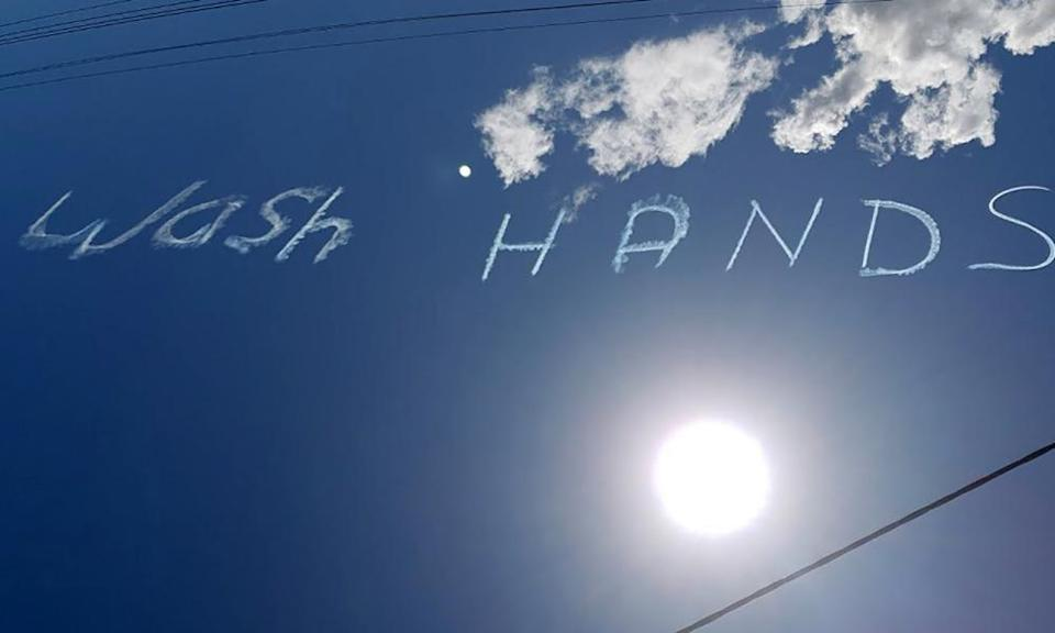 'Wash hands' written in the sky above Sydney on March 13, 2020.
