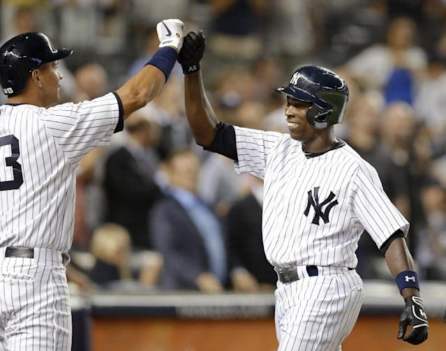 New York Yankees' Alex Rodriguez (13) congratulates Alfonso Soriano, who hit a seventh-inning, three-run home run in a baseball game, Tuesday, Aug. 13, 2013, in New York. It was Soriano's second home run of the game. (AP Photo/Kathy Willens)