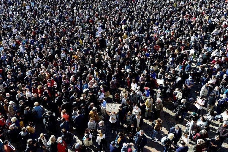 Tens of thousands rallied across France on Sunday in solidarity with the murdered teacher