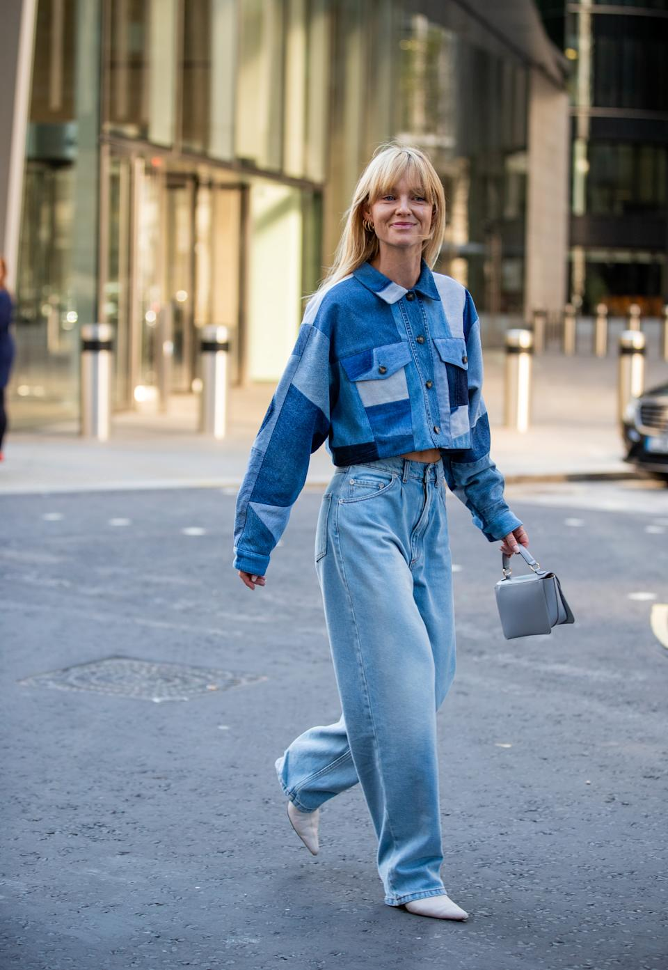 Jeanette Friis Madsen is seen wearing denim jeans and a coordinating patchwork denim jacket outside David Koma. [Photo: Getty Images]