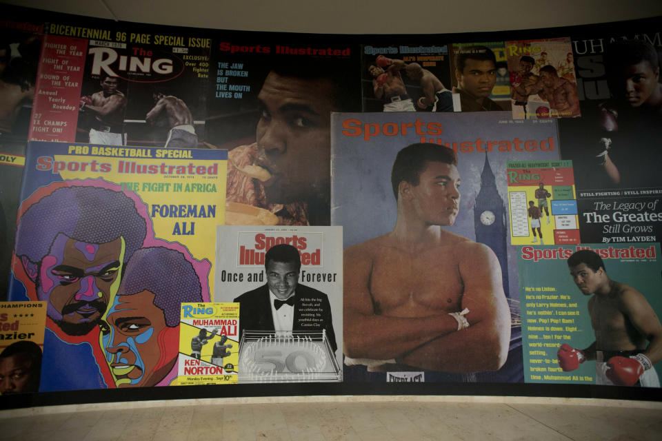 "FILE - In this June 4, 2016, file photo large posters of mostly Sports Illustrated magazine covers are displayed at the ""I Am The Greatest, Muhammad Ali"" exhibition at the O2 arena, which hosts high profile boxing fights in London. Sports Illustrated is being sold for $110 million, but the seller will continue running the iconic magazine under a licensing deal. Authentic Brands Group is buying Sports Illustrated from Meredith Corp. (AP Photo/Matt Dunham, File)"