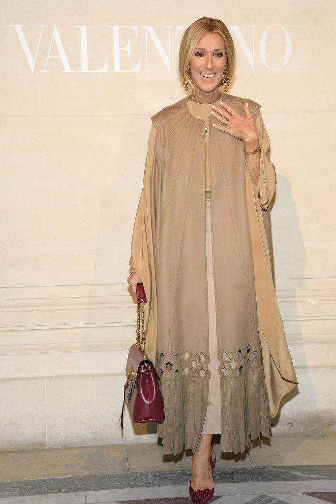 <p>While attending the Valentino Couture show in Paris, Dion looked chic in a monochromatic camel look accessorized with a deep red bag and pumps. </p>