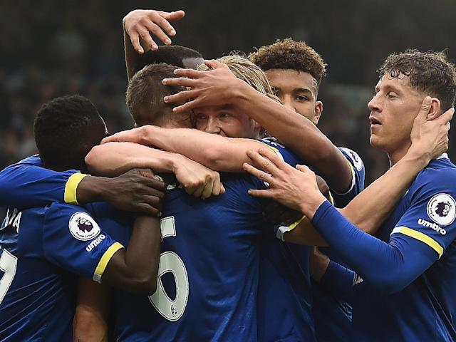 Davies is mobbed by his team-mates after giving Everton the lead within thirty seconds: AFP/Getty