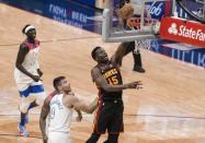Atlanta Hawks center Clint Capela (15) shoots past New Orleans Pelicans center Willy Hernangomez (9) in the second quarter of an NBA basketball game in New Orleans, Friday, April 2, 2021. (AP Photo/Derick Hingle)