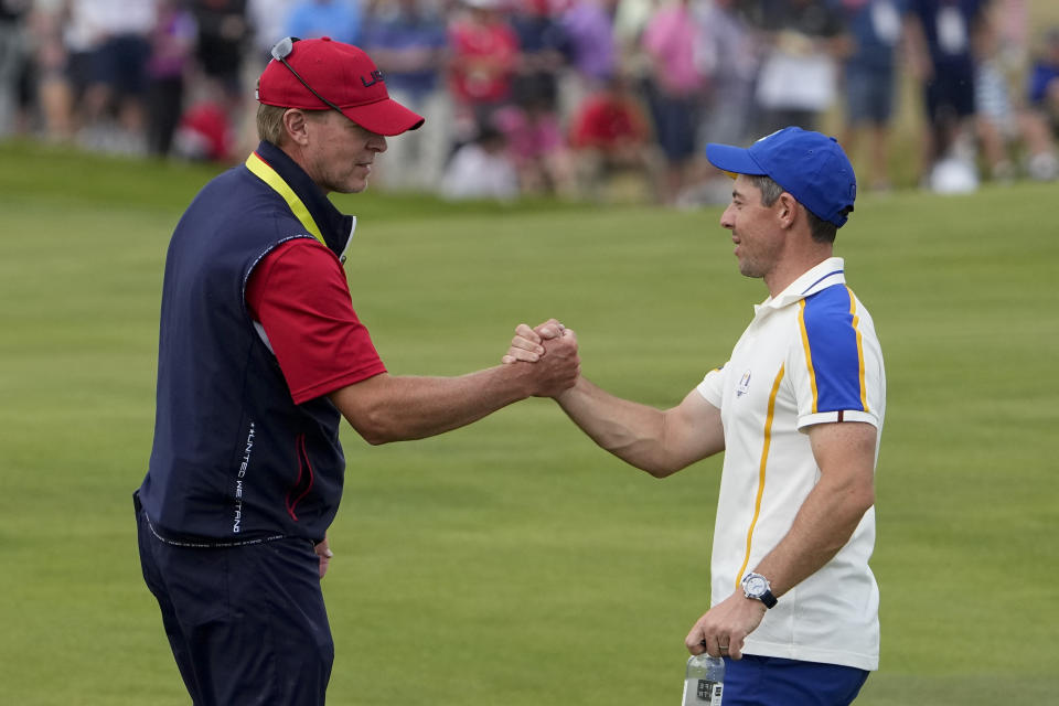 Team USA captain Steve Stricker shakes hands with Team Europe's Rory McIlroy during a Ryder Cup singles match at the Whistling Straits Golf Course Sunday, Sept. 26, 2021, in Sheboygan, Wis. (AP Photo/Jeff Roberson)