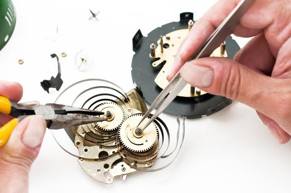 Watchmaker working on a complicated clockwork system.