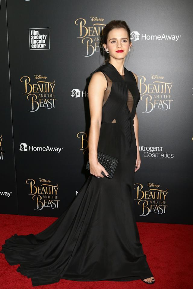 <p>Emma's flowing black gown with sheer panels was the perfect amount of sophistication for New York's Beauty And The Beast Premiere [Photo: PA] </p>