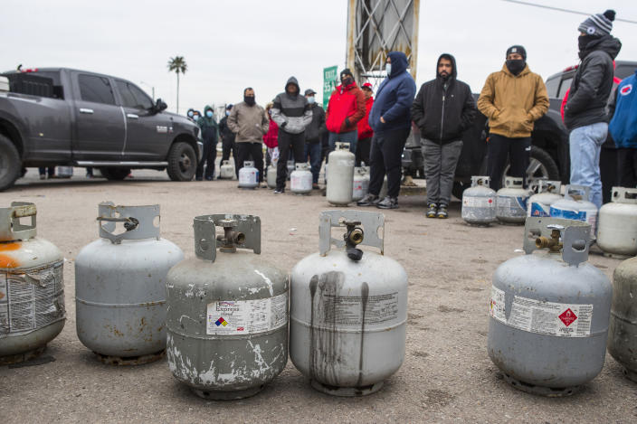 People line up to fill their empty propane tanks Tuesday, Feb. 16, 2021, in Houston. Temperatures stayed below freezing Tuesday, and many residents were without electricity. (Brett Coomer/Houston Chronicle via AP)
