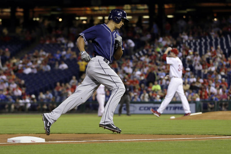 San Diego Padres' Will Venable rounds the bases after hitting a home run off Philadelphia Phillies starting pitcher Roy Halladay during the first inning of a baseball game, Thursday, Sept. 12, 2013, in Philadelphia. (AP Photo/Matt Slocum)