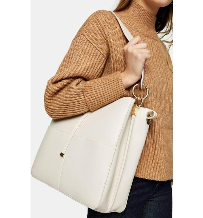 <p>This <span>Topshop Double Pocket Faux Leather Hobo</span> ($58) also comes in black.</p>