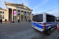 Police car parks outside Green Vault city palace after a robery in Dresden