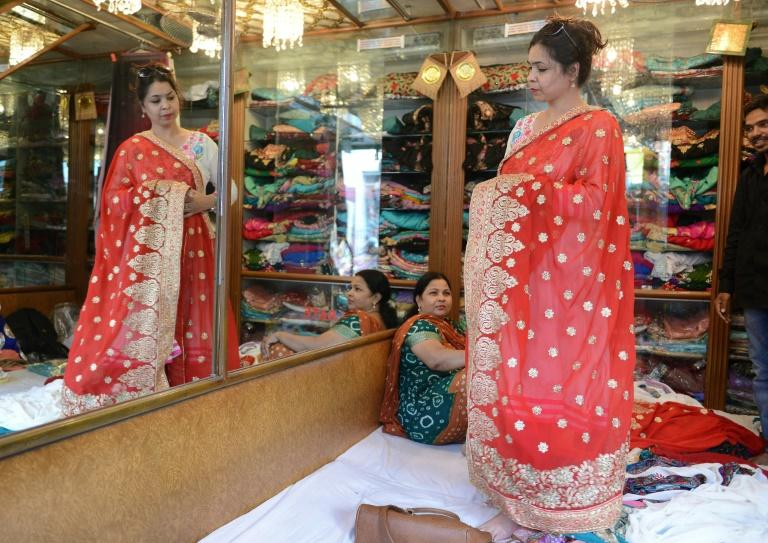 A woman looks at sarees in a store in the Indian city of Hyderabad
