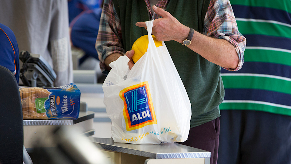 Man packs aldi grocery bag