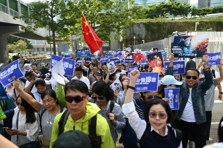 A group of around 500 people staged a rally near the government headquarters in support of the Hong Kong police force (AFP Photo/Ye Aung THU)