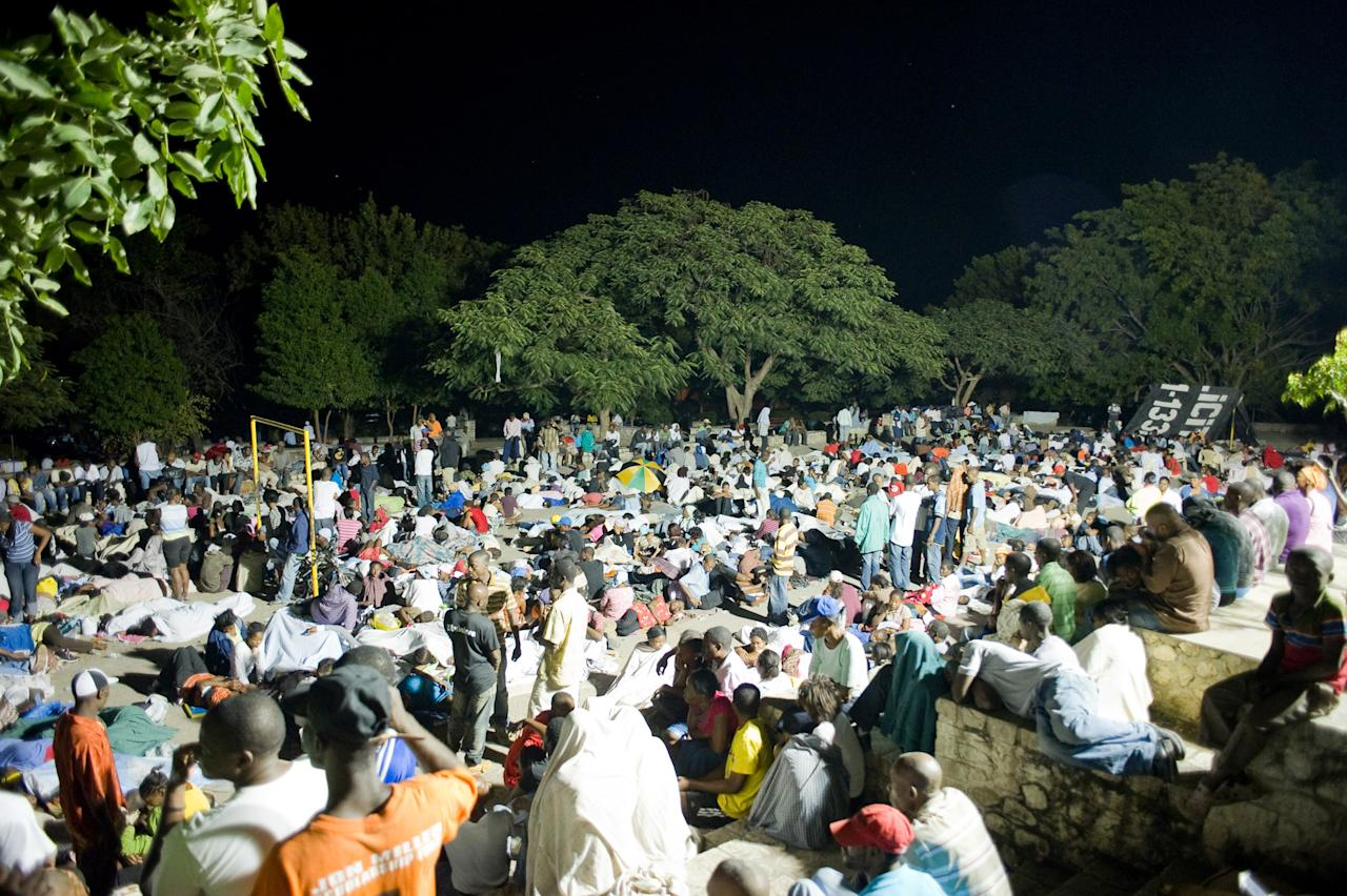<p>Displaced people gather on Place Boyer in Petion-Ville to spend the night, following a major earthquake on Jan.13, 2010 in Port-au-Prince, Haiti. A 7.0 earthquake rocked Haiti today, followed by at least a dozen aftershocks, causing widespread devastation in the capital of Port-au-Prince. (Photo: Frederic Dupoux/Getty Images) </p>