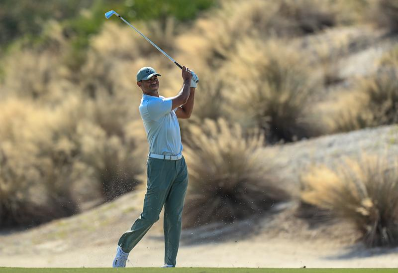 Reed grabs outright lead as Tiger goes low