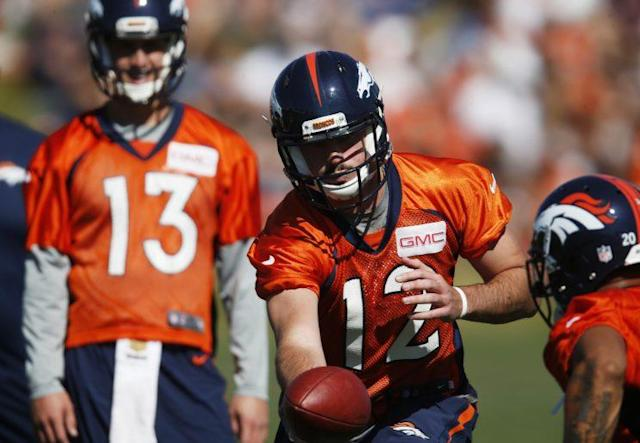 Paxton Lynch (12) and Trevor Siemian (13) are each vying for the starting QB spot for Denver. (AP)