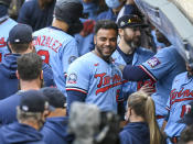 Minnesota Twins Minnesota Twins Nelson Cruz, center, smiles in the dugout after the Twins clinched the AL Central championship with the Chicago White Sox's loss during the tenth inning of a baseball game Sunday, Sept. 27, 2020, in Minneapolis. The Reds won 5-3. (AP Photo/Craig Lassig)
