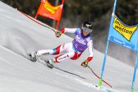 Switzerland's Lara Gut-Behrami speeds down the course during an alpine ski, women's World Cup super-G in St. Anton, Austria, Sunday, Jan.10, 2021. (AP Photo/Marco Trovati)