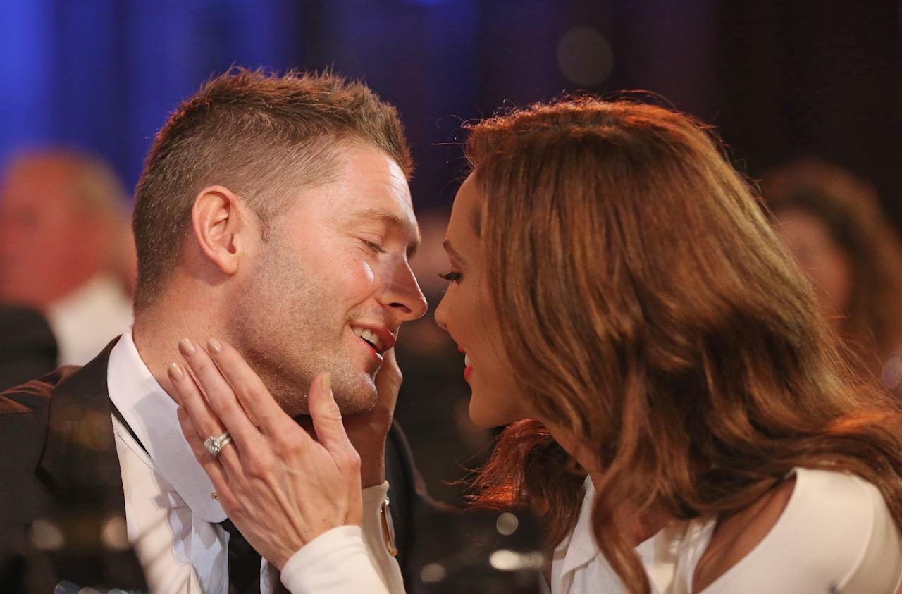 MELBOURNE, AUSTRALIA - FEBRUARY 04:  Michael Clarke of Australia is kissed by his wife Kyly Clarke after winning the Allan Border Medal during the 2013 Allan Border Medal awards ceremony at Crown Palladium on February 4, 2013 in Melbourne, Australia.  (Photo by Scott Barbour/Getty Images)